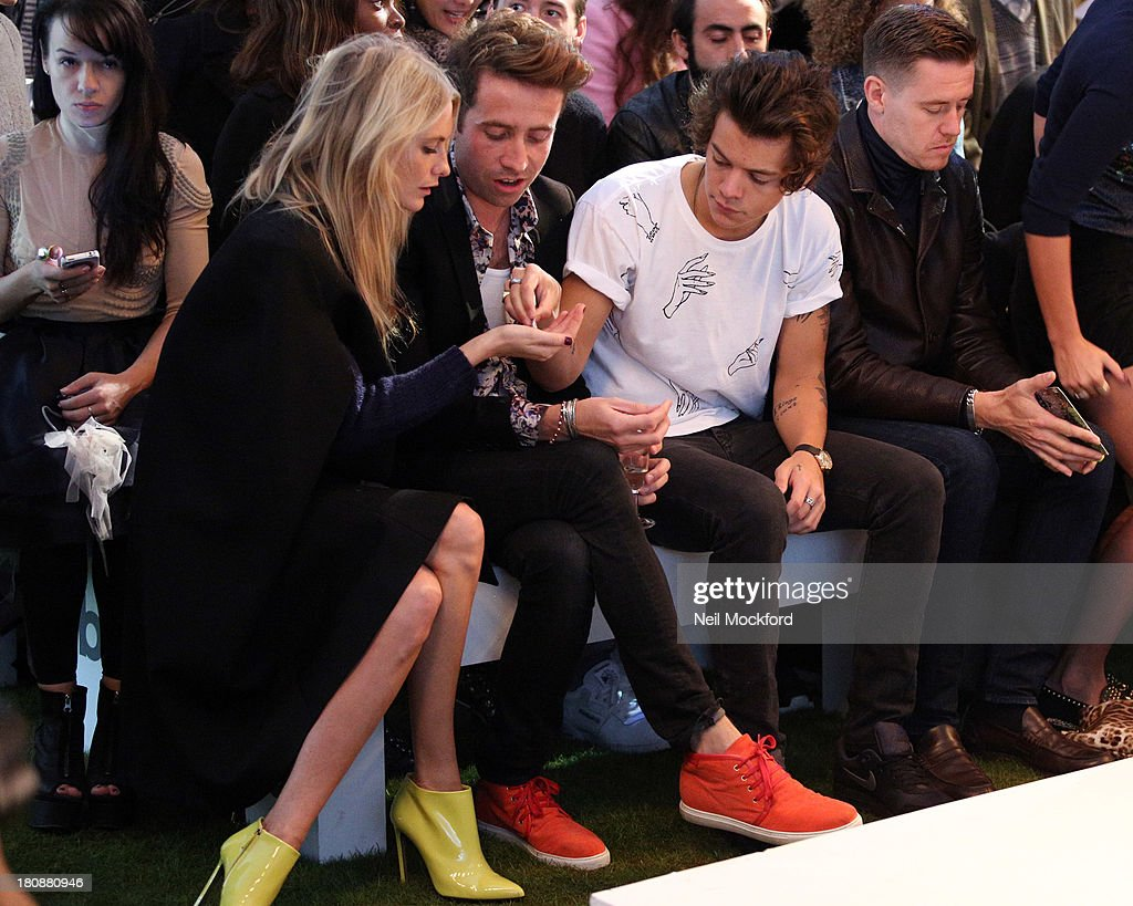 Poppy Delevingne, Nick Grimshaw and Harry Styles seen at a Fashion East fashion show on September 17, 2013 in London, England.