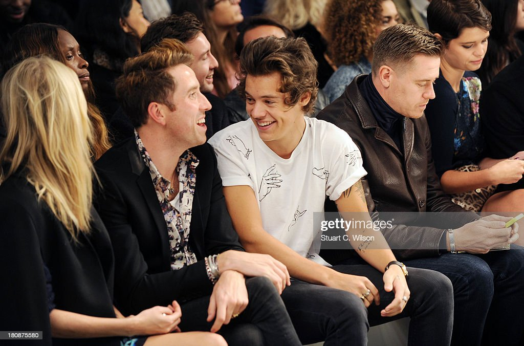 Poppy Delevingne, Nick Grimshaw, Harry Styles, guest and Pixie Geldof attend the Fashion East show during London Fashion Week SS14 at TopShop Show Space on September 17, 2013 in London, England.