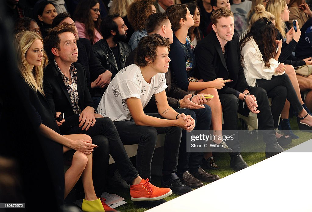 Poppy Delevingne, Nick Grimshaw, Harry Styles, guest, Pixie Geldof and George Barnett attend the Fashion East show during London Fashion Week SS14 at TopShop Show Space on September 17, 2013 in London, England.