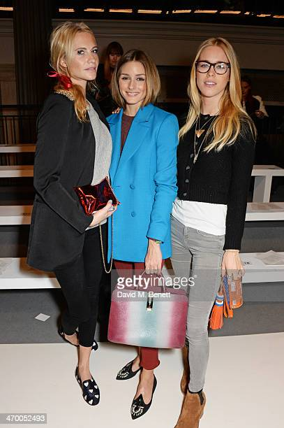 Poppy Delevingne Olivia Palermo and Mary Charteris attend the Anya Hindmarch AW14 show at The Old Billingsgate on February 18 2014 in London England
