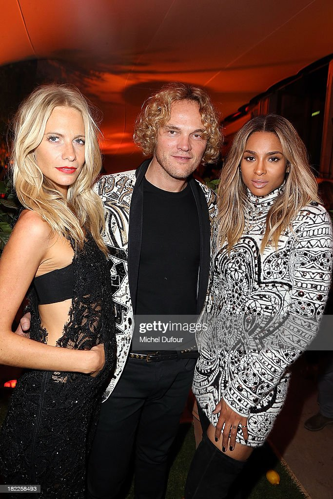 Poppy Delevingne, Peter Dundas and Ciara Princess Harris attend The Pucci Dinner Party At Monsieur Bleu In Paris on September 28, 2013 in Paris, France.
