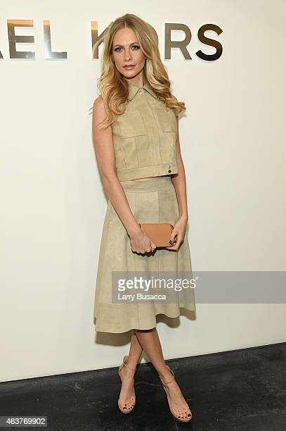 Poppy Delevingne poses backstage at the Michael Kors fashion show during MercedesBenz Fashion Week Fall 2015 at Spring Studios on February 18 2015 in...