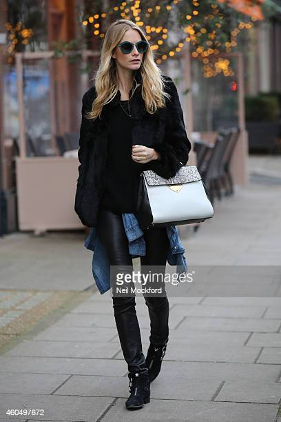 Poppy Delevingne wears the new Coccinelle B14 Bag in London on December 15 2014 in London England