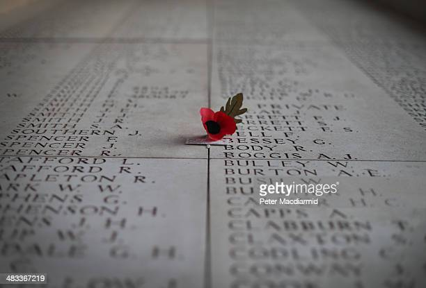 A poppy flower sits on a panel showing some of the names of the 54407 identified casualties at the Menin Gate Memorial to the Missing on March 26...