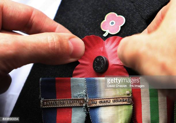 A poppy is placed on the blazer of 92yearold retired Wing Commander Roger Morewood for the launch the Scottish Poppy Appeal for 2007 at Lady Haig's...