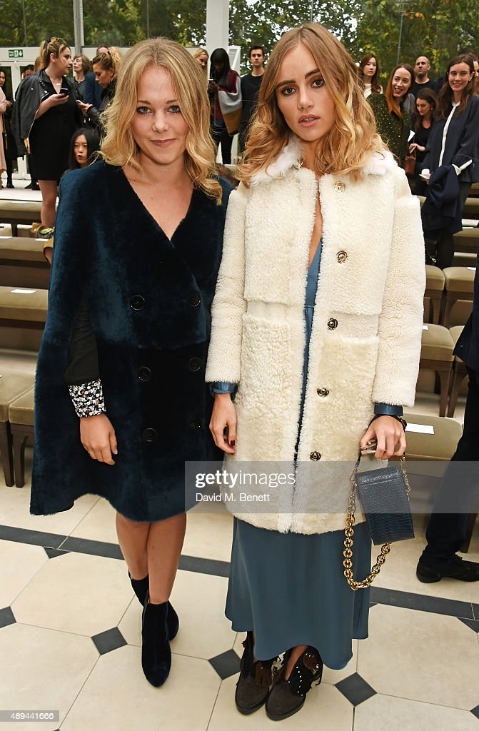 Poppy Jamie and Suki Waterhouse attend the Burberry Womenswear Spring/Summer 2016 show during London Fashion Week at Kensington Gardens on September...
