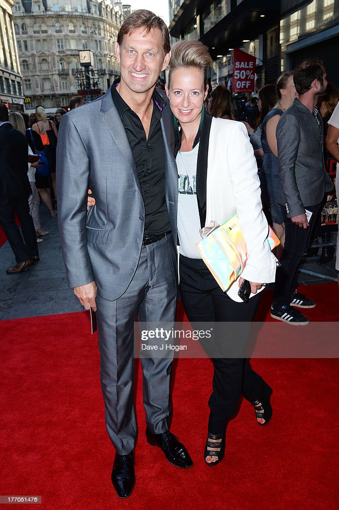 Poppy Teacher and Tony Adams attend the world premiere of 'One Direction - This Is Us' at The Empire Leicester Square on August 20, 2013 in London, England.