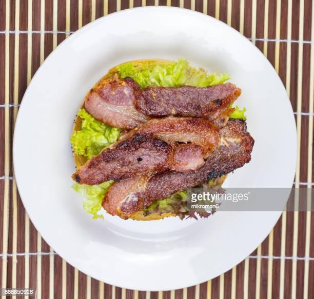 Poppyseed Bagel Sandwich with Bacon. Breakfast