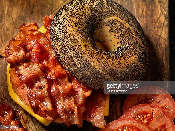 Poppyseed Bagel Sandwich with Bacon, Cheese and Tomatoes