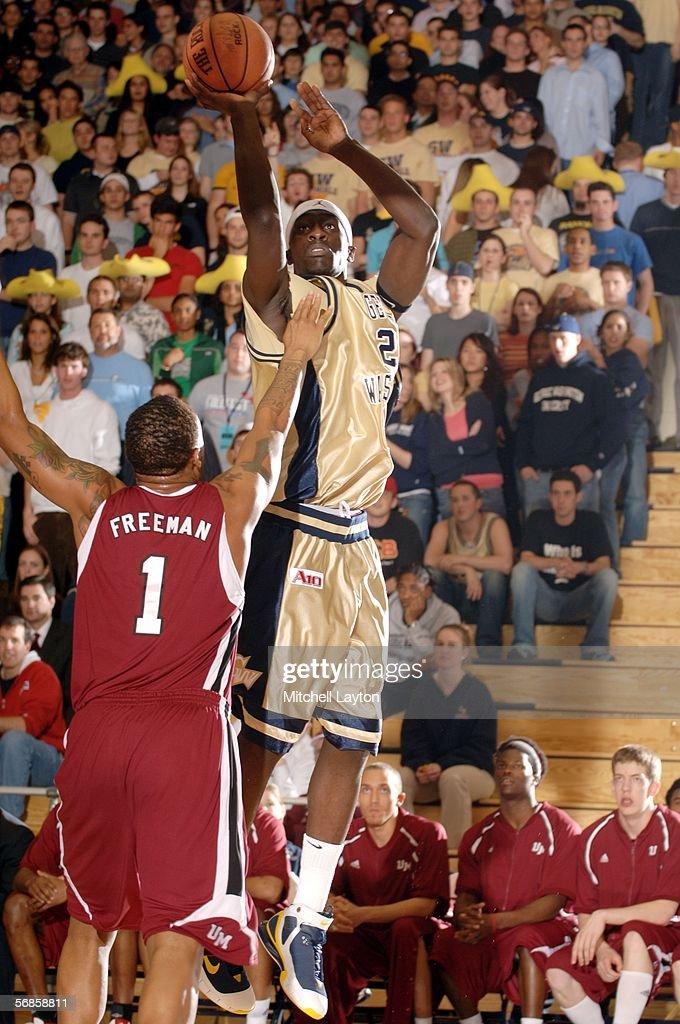 Pops MensahBonsu of George Washington takes a jump shot against Rashaun Freeman of UMass on February 15 2006 at Smith Center in Washington DC George...