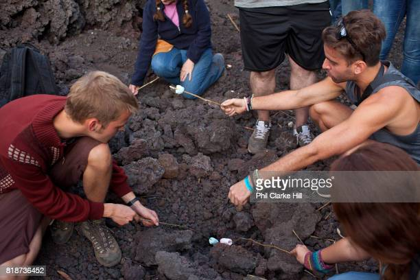 A popular activity at Pacaya is toasting marshmallows on the still smouldering pile of lava near the base Pacaya is an active volcano in Guatemala...