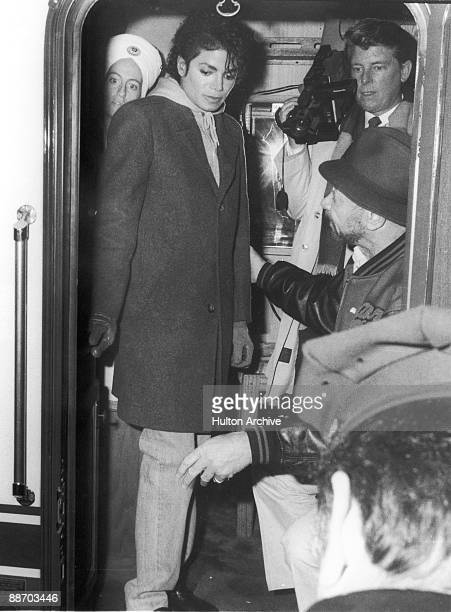Popular American musician Michael Jackson stands inside the door of subway train and speaks with crew members during the filming of the longform...