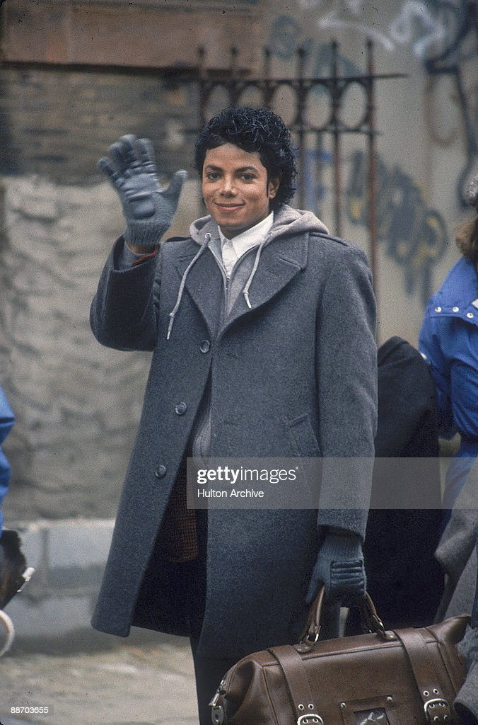 Popular American musician Michael Jackson waves during the filming of the longform music video for his song 'Bad' directed by Martin Scorcese New...