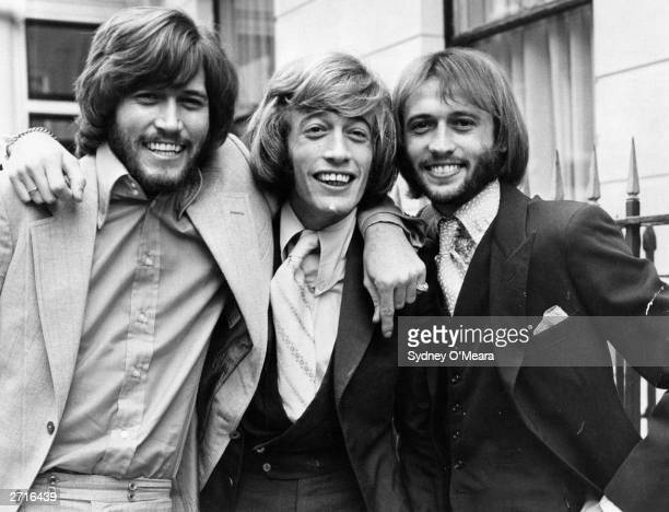Popular English vocal trio the Bee Gees from left to right brothers Barry Robin and Maurice Gibb