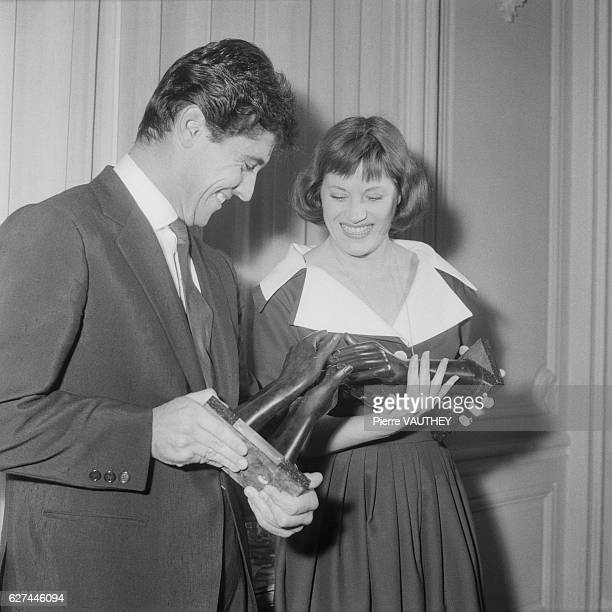 Popular French singers Sacha Distel and Colette Renard hold their Bravo du MusicHall awards given by a magazine of the same name between 1955 and 1962