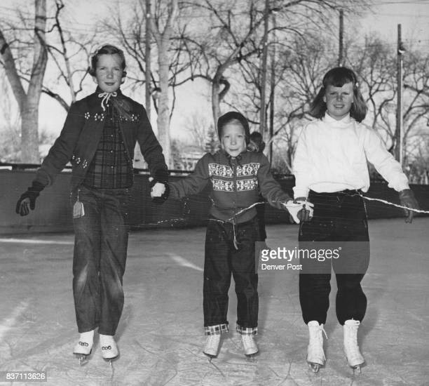 Popular gathering spot for the young set on wintry afternoons is the glassy skating rink at the Denver Country club Trio taking to the ice are Debra...