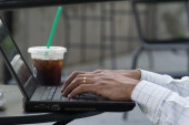 A popular internet obsession is surfing the net while having coffee in The Manhattan Borough of New York New York USA