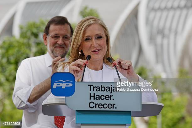 Popular Party candidate for president of Madrid Community Cristina Cifuentes speaks to members of the public as PP leader Mariano Rajoy stand behind...