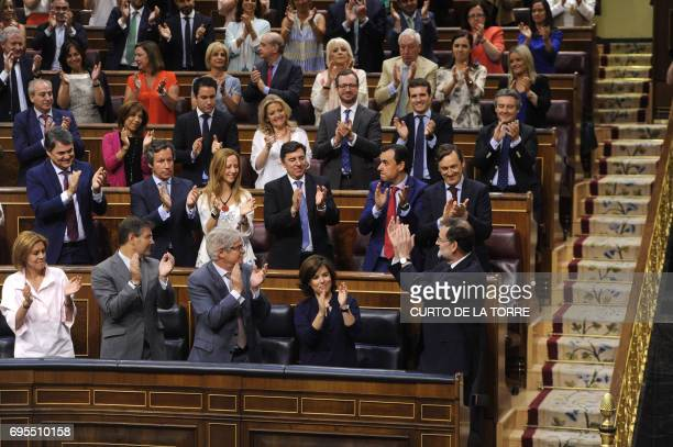 Popular Party duputies clap after a speech by Spanish Prime Minister Mariano Rajoy at the Congress of Deputies in Madrid on June 13 2017 before a...
