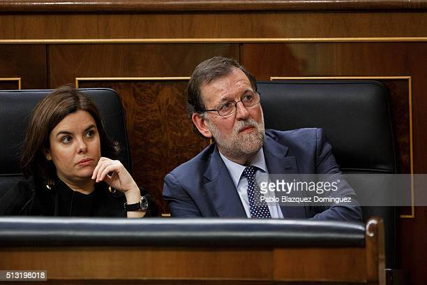Popular Party leader Mariano Rajoy and Soraya Saenz de Santamaria listen the speech of Spanish Socialist Party leader Pedro Sanchez during a debate...