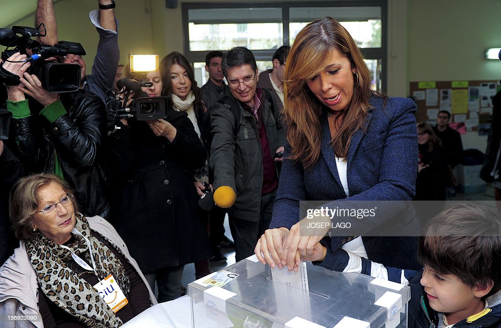 Popular Party (PP) leader of the Catalonia region Alicia Sanchez Camacho, flanked by her son (L) casts her ballot for regional elections in Barcelona on November 25, 2012. The leader of Spain's Catalonia region, Artur Mas has rallied crowds cheering for independence to fight for 'freedom' in snap elections that he has cast as a vote for nationhood. Latest polls show Mas's nationalist alliance, the conservative Convergence and Union, heading for a win in Sunday's vote but falling short of the absolute majority he is seeking.