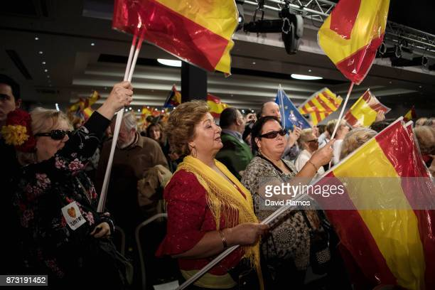 Popular Party of Catalonia supporters react during a rally on November 12 2017 in Barcelona Spain Spain's Prime Minister Mariano Rajoy is in...