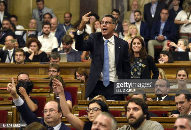 Popular Party PP spokesman Xavier Garcia Albiol protests from his seat as Socialist representative Miguel Iceta asks the president of parliament to...