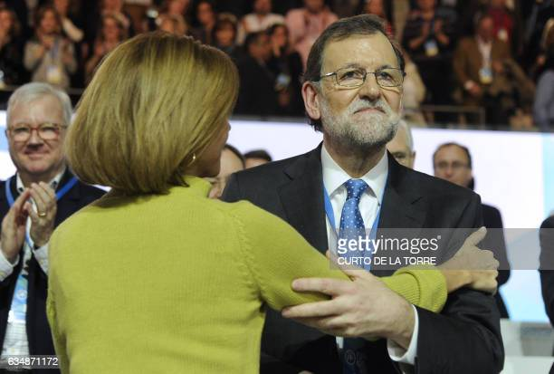 Popular Party Secretary Gerenal and Spanish Defense minister Maria Dolores de Cospedal congratulates Spanish Prime Minister Mariano Rajoy during the...