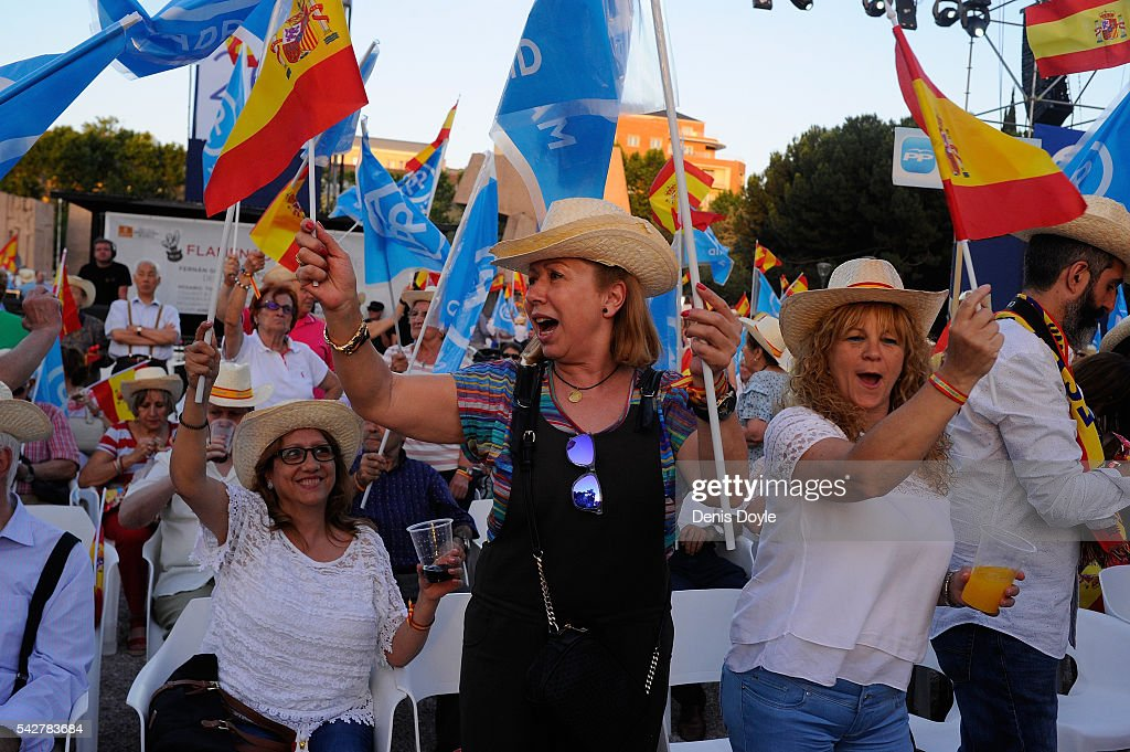 Popular Party supporters wave Spanish flags during the closing rally ahead of Spanish General Elections on June 24, 2016 in Madrid, Spain. Spanish voters head back to the polls on June 26 after the last election in December failed to produce a government. Latest opinion polls suggest the Unidos Podemos left-wing alliance could make enough gains to come in second behind the caretaker government of the center-right Popular Party.