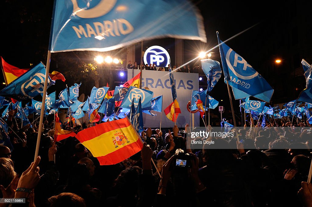 Popular Party supporters wave to Spanish Prime Minister Mariano Rajoy on the balcony at Popular Party headquarters after his party won the most votes during General Elections on December 20, 2015 in Madrid, Spain. Spaniards went to the polls today to vote for 350 members of the parliament and 208 senators. For the first time since 1982, the two traditional Spanish political parties, right-wing Partido Popular (People's Party) and centre-left wing Partido Socialista Obrero Espanol PSOE (Spanish Socialist Workers' Party), held a tight election race with two new contenders, Ciudadanos (Citizens) and Podemos (We Can) attracting right-leaning and left-leaning voters respectively.