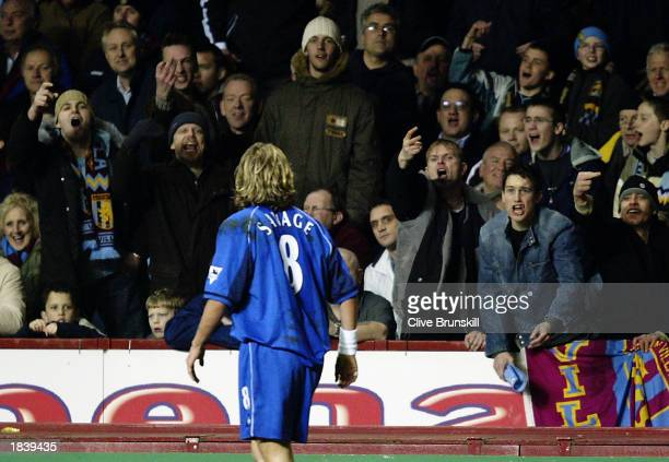 A popular Robbie Savage of Birmingham City is greeted by Aston Villa fans during the FA Barclaycard Premiership match between Aston Villa and...