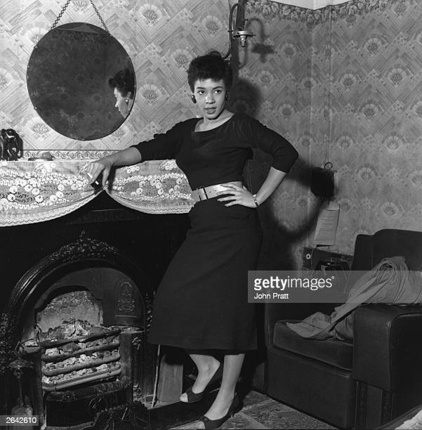 Popular young Welsh singer Shirley Bassey relaxes with a cigarette by the fireside in her little cottage in Cardiff's Tiger Bay the road to success...