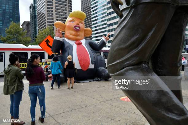 A popup inflatable 'Trump Rat' is erected facing the Frank Rizzo statue in Center City Philadelphia PA on Rizzos birthday October 23 2017 In recent...