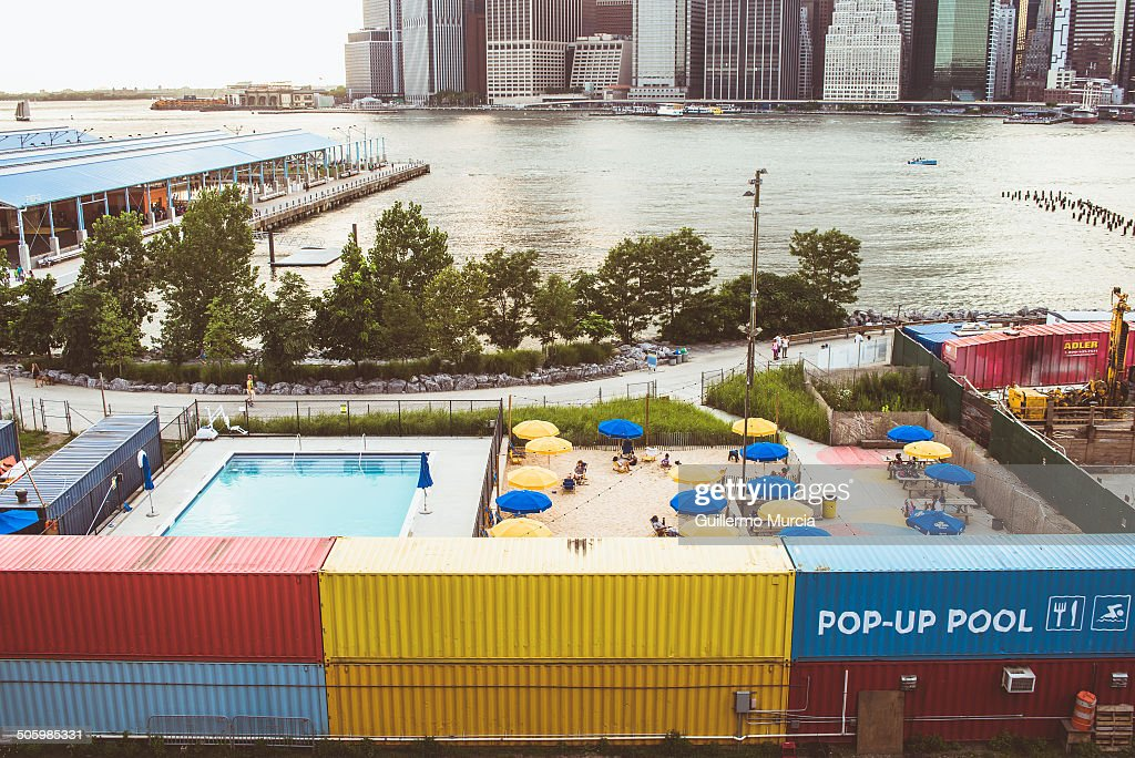 NYC popup pool and beach at the Brooklyn Bridge Park in New York City with views of Lower Manhattan's Financial District