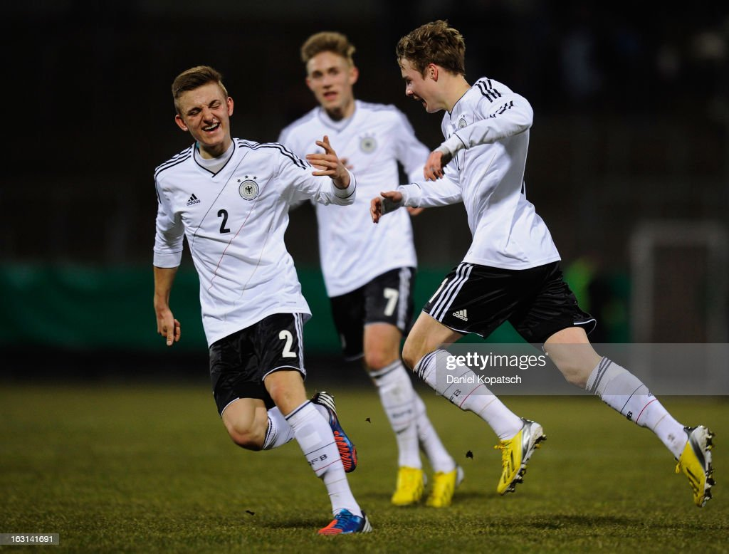Porath Finn of Germany (R) celebrates his team's first goal with team mate Ramser Lukas (L) during the U16 international friendly match between Germany and Italy on March 5, 2013 at Waldstadion in Homburg, Germany.