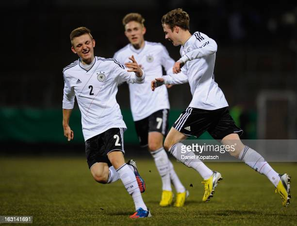 Porath Finn of Germany celebrates his team's first goal with team mate Ramser Lukas during the U16 international friendly match between Germany and...