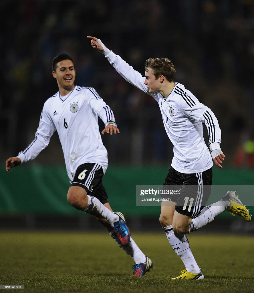 Porath Finn of Germany (R) celebrates his team's first goal with team mate Ufuk Akyoi during the U16 international friendly match between Germany and Italy on March 5, 2013 at Waldstadion in Homburg, Germany.