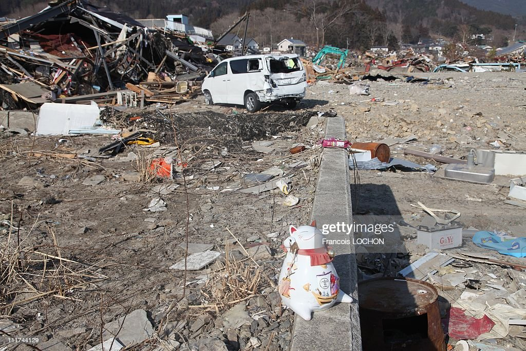 A porcelain cat is left in the rubble destroyed by the earthquake on April 4,2011, in Yamda,Japan. These objects are from the 30 000 victims of the earthquake that hit Japan on March 11, 2011 followed by an tsunami.