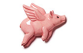 Porcelain pink flying pig on white background