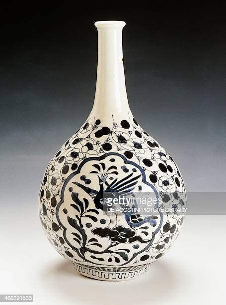 Porcelain sake bottle decorated with figures of two lapwings and plum blossoms 19th century height 285 cm produced in Tobe Japanese civilisation Edo...