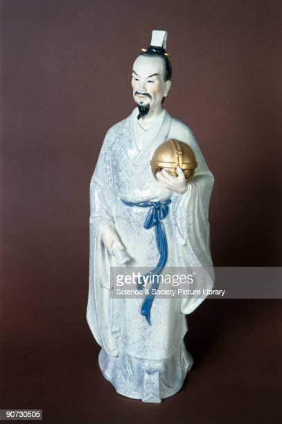 Porcelain statuette of the Chinese astronomer mathematician and seismologist Zhang Heng who described the earliest seismoscope known in about 132 AD...