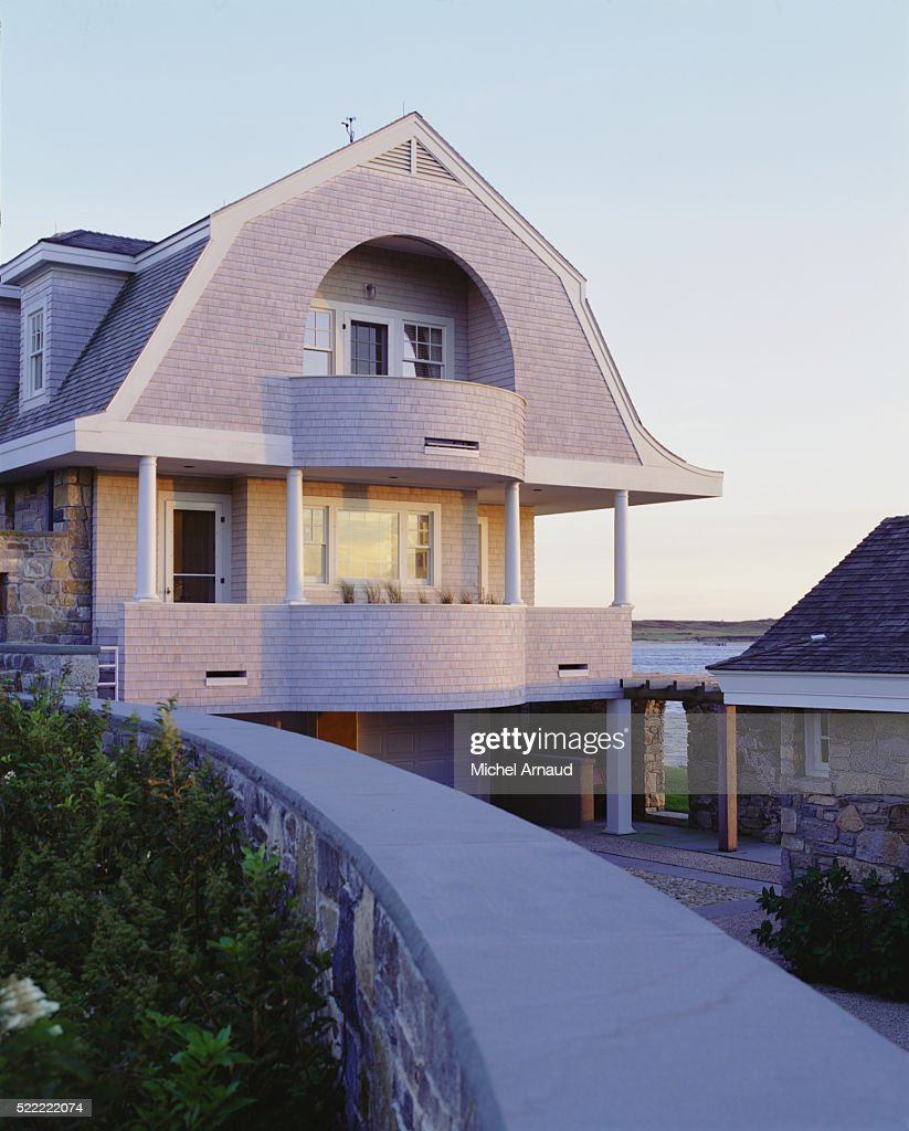 porch and balcony under gambrel roof of house stock photo getty