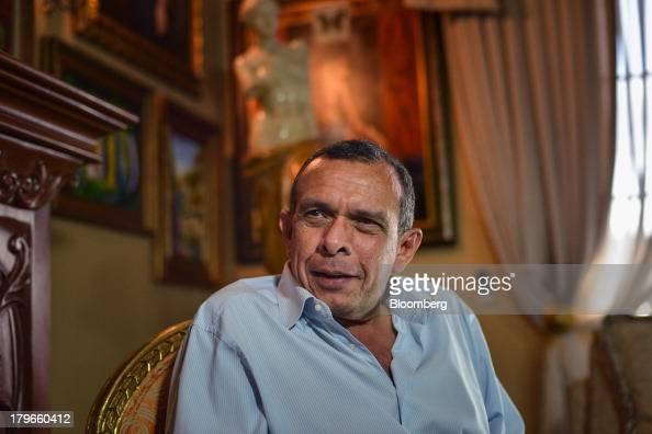 Porfirio Lobo Honduras's president speaks during an interview in Tegucigalpa Honduras on Thursday Sept 5 2013 A 150 percent increase in public sector...
