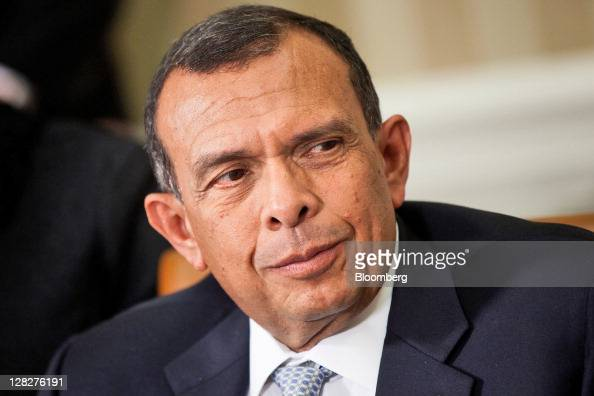 Porfirio Lobo president of Honduras listens to US President Barack Obama at a bilateral meeting in the Oval Office of the White House in Washington...
