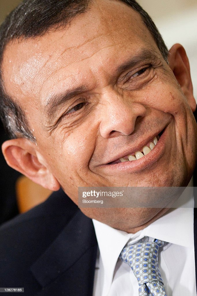 Porfirio Lobo, president of Honduras, smiles before a bilateral meeting with U.S. President Barack Obama in the Oval Office of the White House in Washington, D.C., U.S., on Wednesday, Oct. 5, 2011. Obama and Lobo discussed economic and security issues. Photographer: Brendan Smialowski/Bloomberg via Getty Images