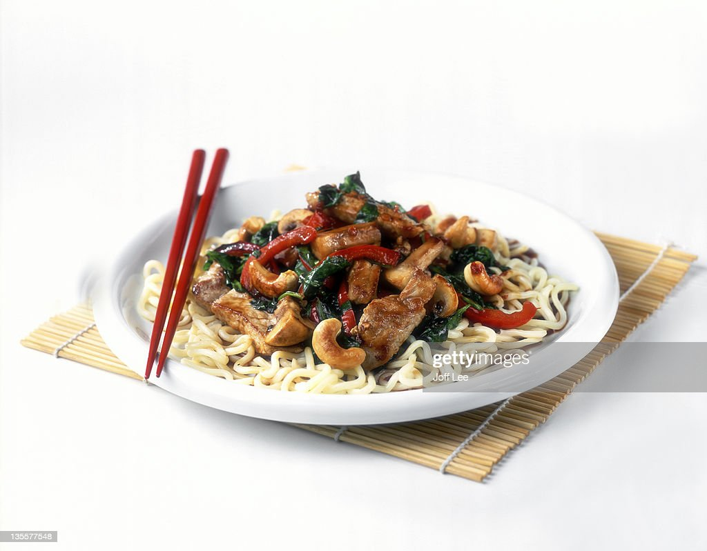 Pork and cashew stir fry with noodles : Stock Photo