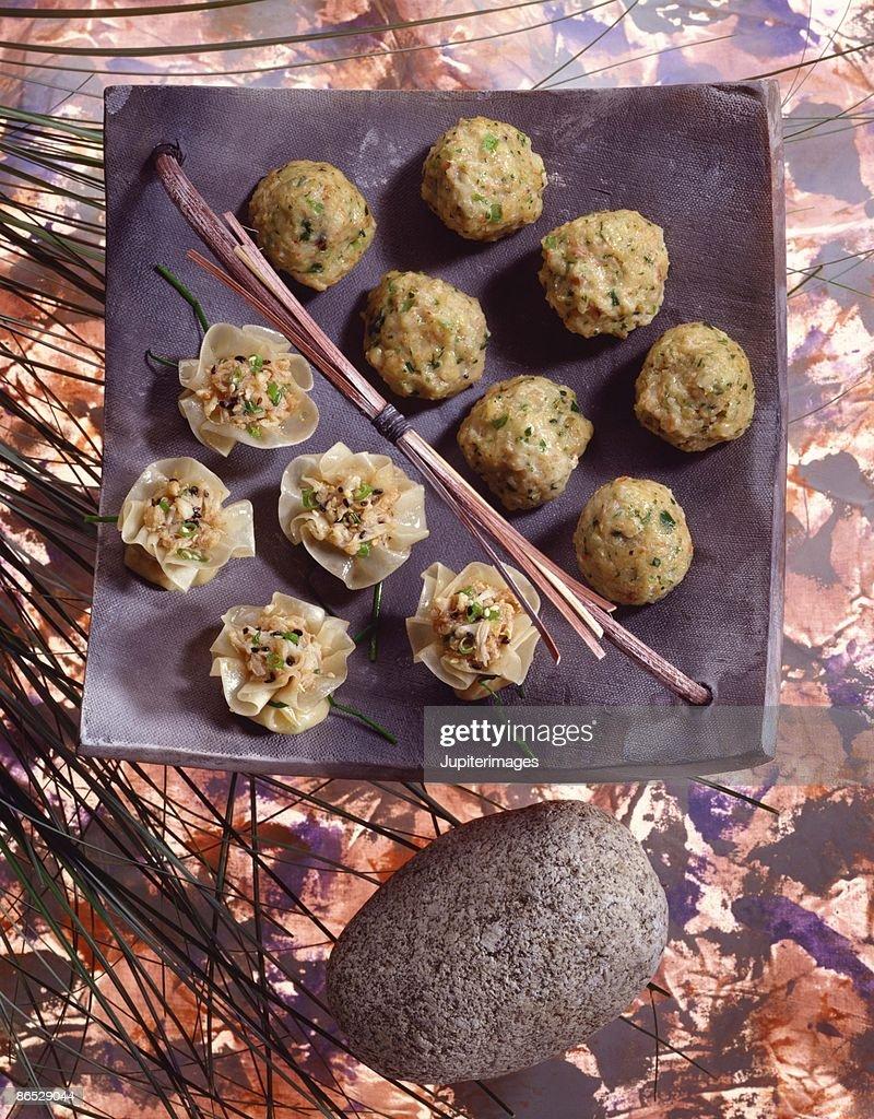 Pork and shrimp balls and wonton blossoms : Stock Photo