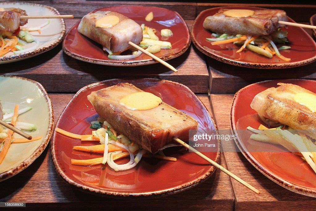 Pork Belly Skewers Al Pastor dish made at the InterContinental Miami Kitchen Passport Tasting Event at InterContinental Miami on December 13, 2012 in Miami, Florida.