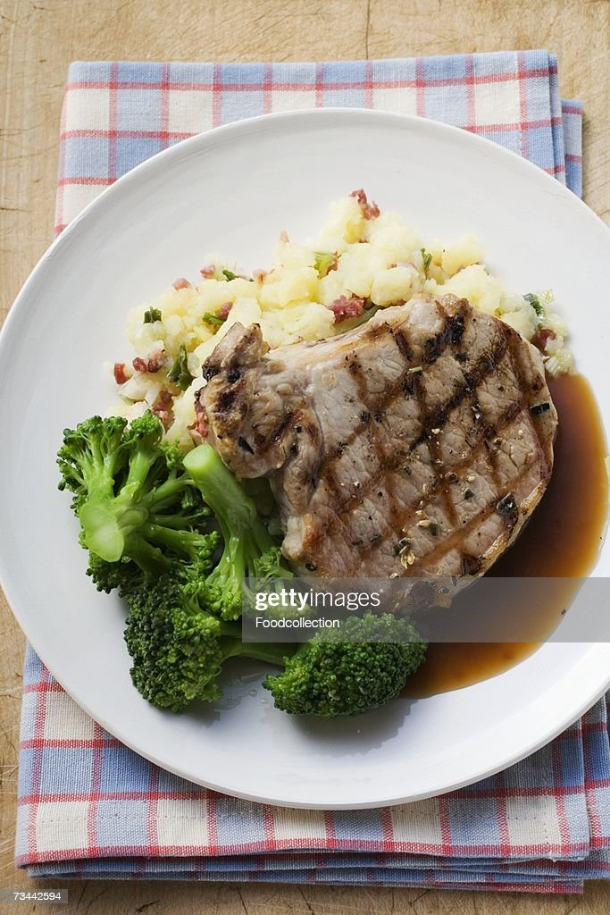 Pork chop with broccoli and mashed potato : Stock Photo