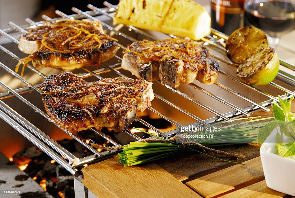 Pork chops on barbecue, close up : Stock Photo